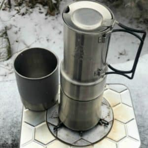 The Espresso-Style Café - Coffee Maker brewing coffee with the nCamp Stove